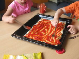 Wir belegen unsere Pizza selber